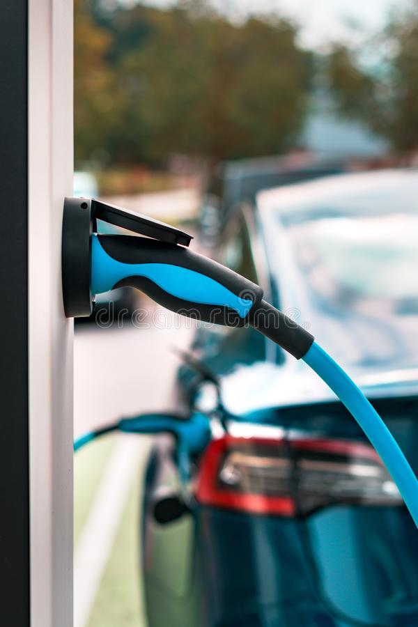 Electric vehicle charging station point stock photo