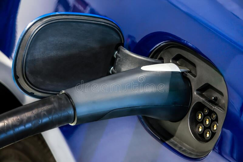 Electric Vehicle charging station system storing power on modern car. EV fuel for advanced hybrid car. automobile industry. stock image