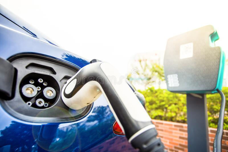 Electric Vehicle charging station system storing power on modern car. EV fuel for advanced hybrid car. automobile industry. stock images