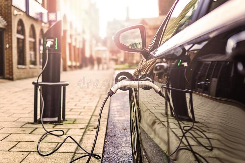 Electric Vehicle charging on street, in UK royalty free stock image
