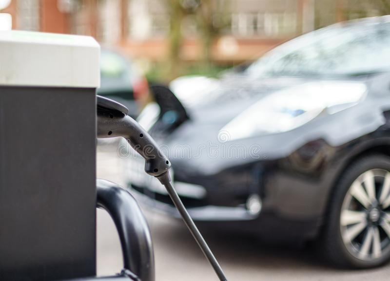 Electric Vehicle charging on street, in UK stock image