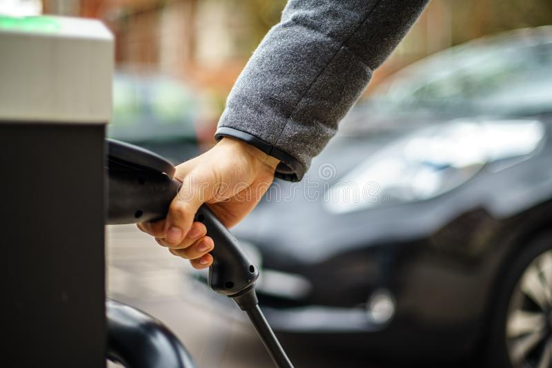 Electric Vehicle charging on street, in UK royalty free stock photos