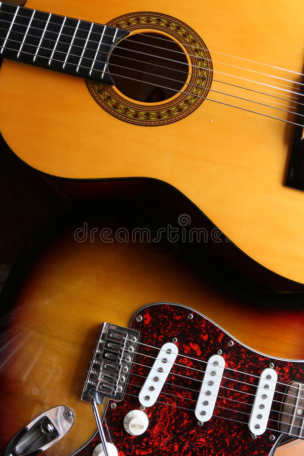 Electric versus classical guitar stock photos