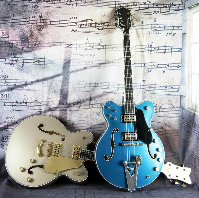 Electric Vintage Guitars against a Musical Backdrop royalty free stock photos