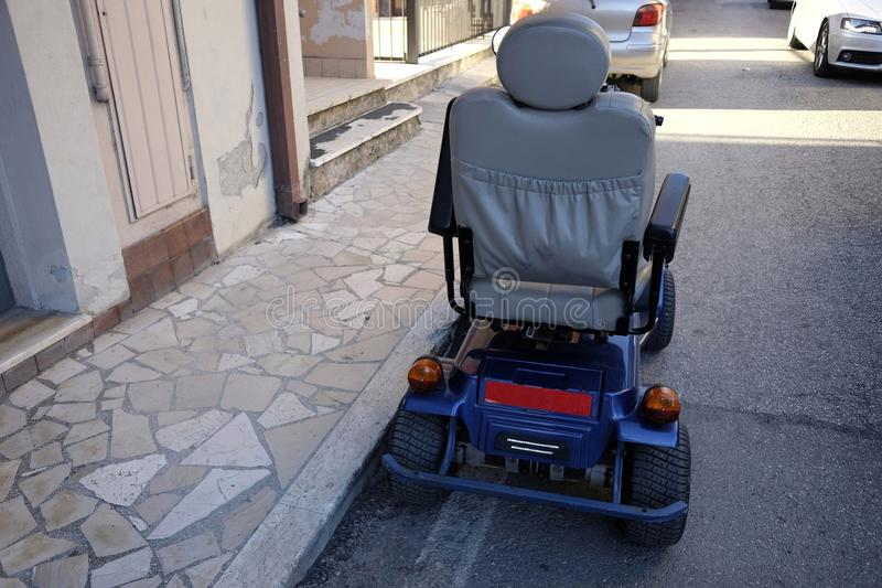 Electric wheelchair. In the city stock photos