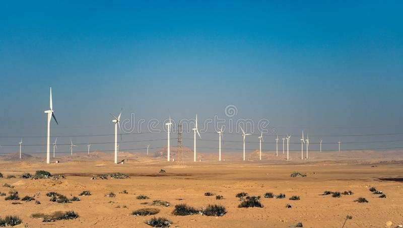 Electric wind turbine generators in the desert in Egypt stock photos