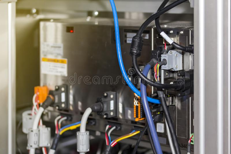 Electric wire connected at backside of computer control box for industrial machine stock images
