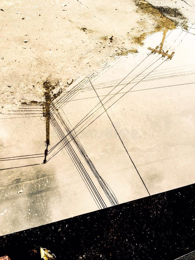 Electric wire on water after rain stock photography