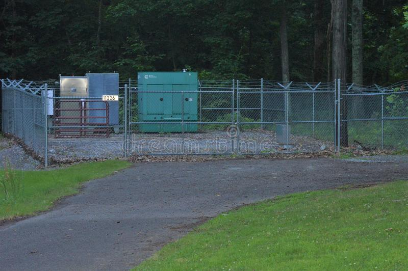 Electrical Boxes inside of a Chain Link Fence stock photos