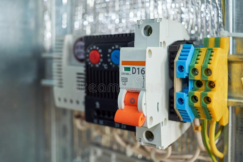 In the electrical Cabinet circuit breaker, thermostat, terminals. Modern reliable equipment to control the engine or pump or fan. There is adjustment on the royalty free stock photo