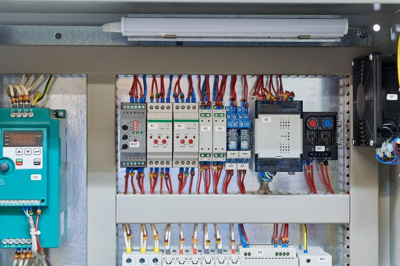 In the electrical Cabinet frequency Converter, controller, relay, thermostat stock photography