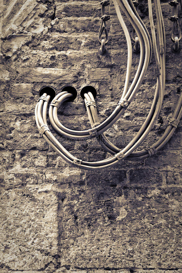 Electrical cables fixed on the wall royalty free stock photos
