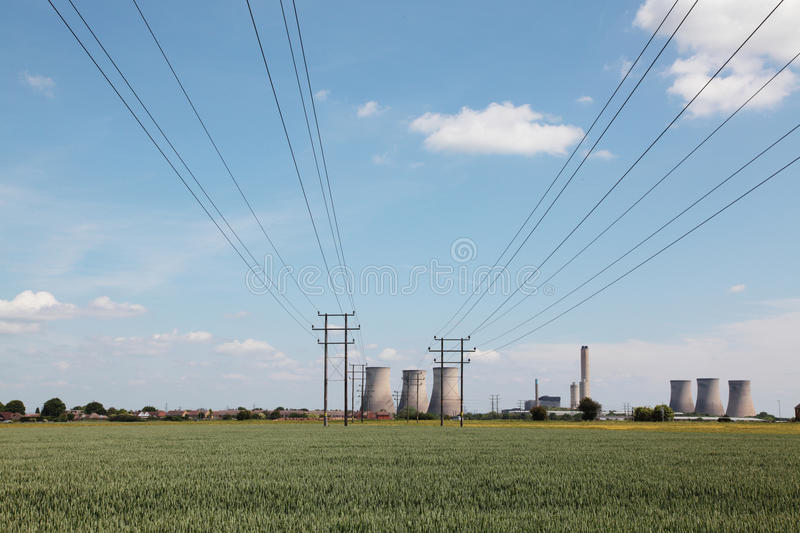 Electrical cables leading to a power plant royalty free stock photos