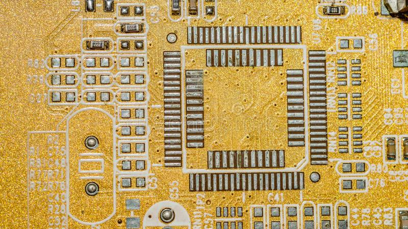 Electrical circuit board with many conductors close up. Technology and engineering royalty free stock photo