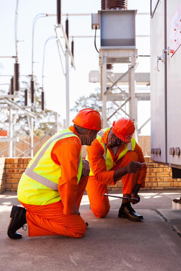 Electrical co-workers substation royalty free stock image