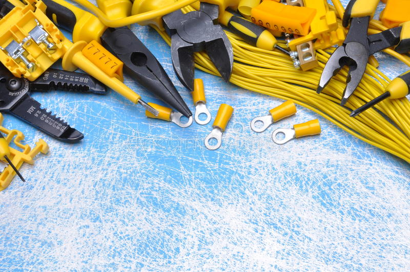Electrical component kit to use in electrical installations. On blue metal background stock photography