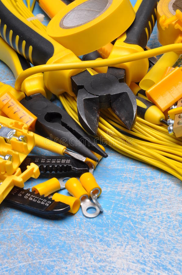 Electrical component kit to use in electrical installations. On blue metal background stock photos