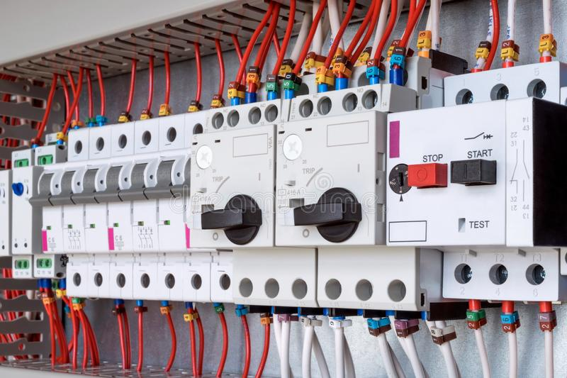 The electrical control panel are circuit breakers protecting the motor royalty free stock image