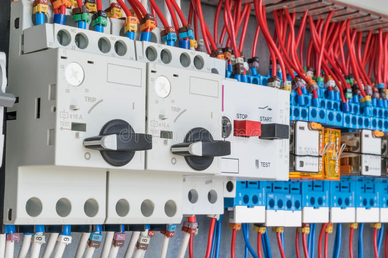 In the electrical control panel are circuit breakers protecting the motor and relay. royalty free stock images