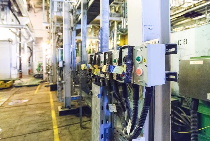 Electrical control panel of extruder machine. Tobolsk, Russia - July 15. 2016: Sibur company. Tobolsk Polymer plant. Electrical control panel of extruder machine royalty free stock photo