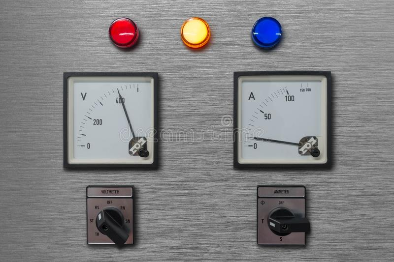 Electrical control panel with volt and amp meter for monitor electricity system with lamp phase signal and selector switch for royalty free stock images