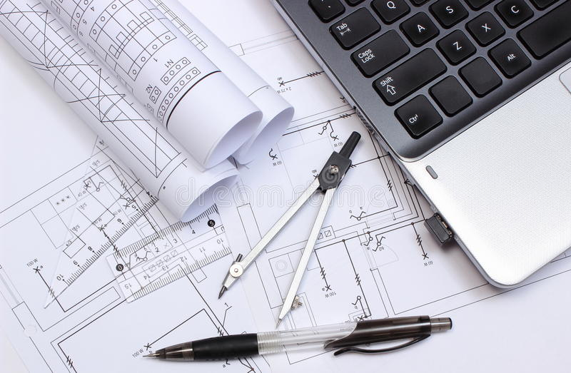 Electrical diagrams, accessories for drawing and laptop stock image
