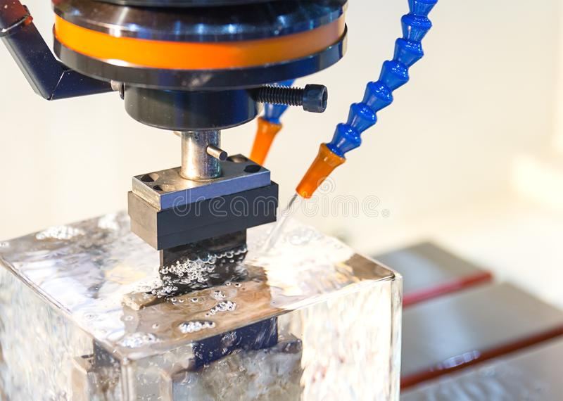 Electrical discharge machine spark eroding with water stock photo