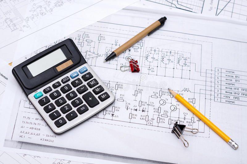 Electrical drawings. With calculator, pencils and paper clips royalty free stock photos
