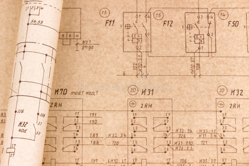 Electrical drawings. Detailed technical drawing and rolled electrical diagram stock photo