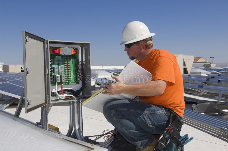 Download Electrical Engineer Holding Book While Analyzing Electricity Box Stock Photo - Image of generation, caucasian: 33899148