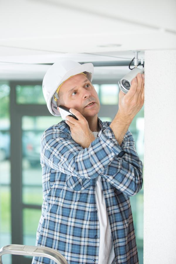 Electrical engineer make phone call to control center stock photos