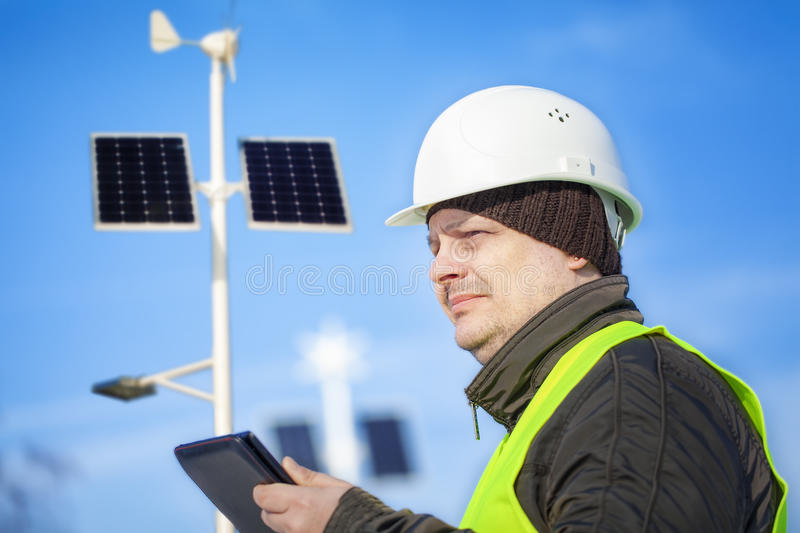 Electrical Engineer with tablet PC near street lighting royalty free stock photography