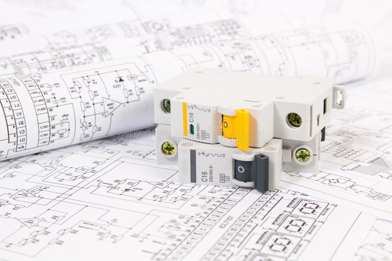 Electrical engineering drawings and modular circuit breaker. Electrical network protection and switching stock image