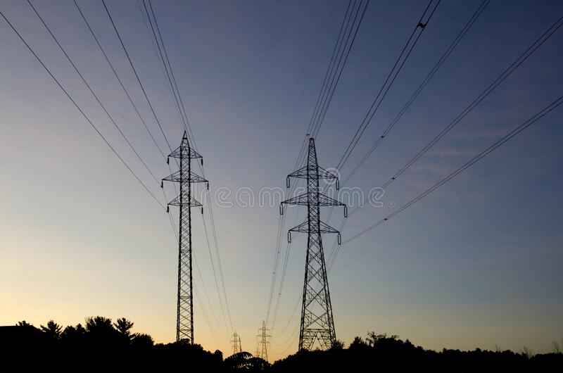 Electrical Hydro Towers and Cables at Sunset royalty free stock photography