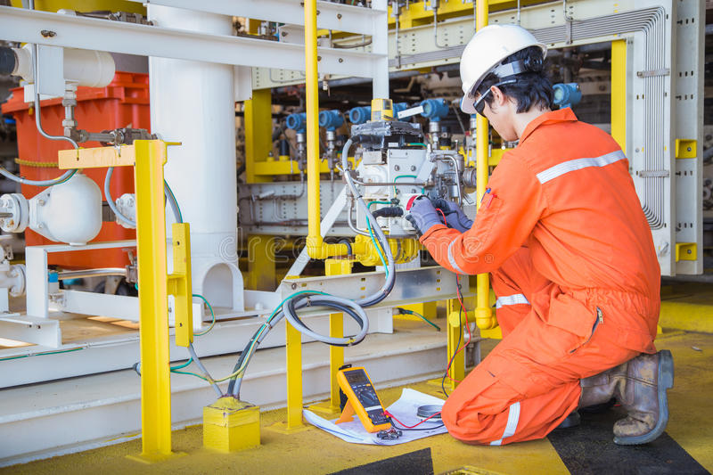 Electrical and instrument technician maintenance electric system at offshore oil and gas processing platform stock photo