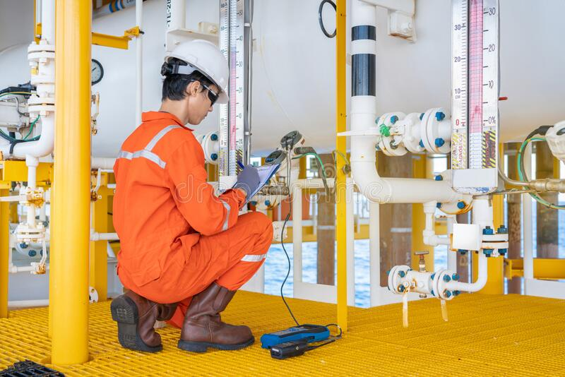 Electrical and instrument technician operator maintenance instrument system at offshore oil and gas platform. stock image