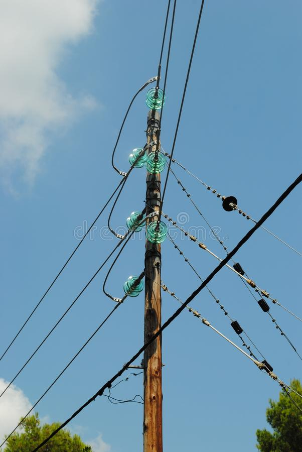 Electrical insulators on power lines stock photography