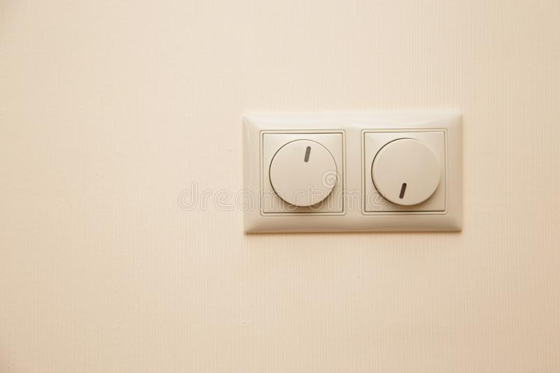 Electrical light dimmer switches on the wall.  stock image