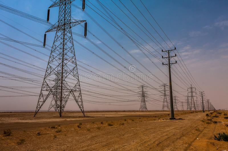 A high-voltage power line in the Riyadh Province, Saudi Arabia stock photo