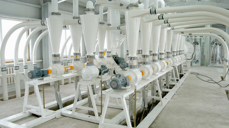 Electrical mill machinery for the production of wheat flour. Grain equipment. Grain. Agriculture. Industrial royalty free stock photos