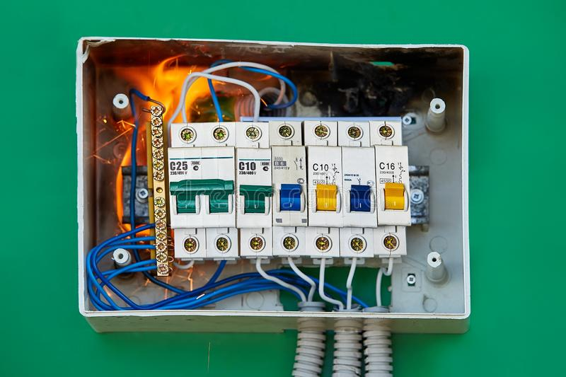 Bad house wiring became the cause fire. Electrical mishaps cause fire. Damaged electrical distribution equipment is cause of home fire stock photography