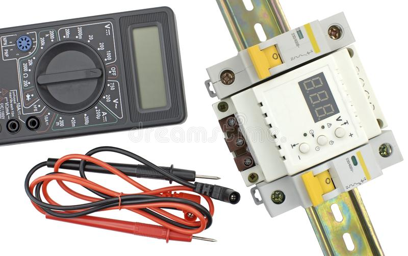Electrical modular circuit breaker and digital multimeter. On white background royalty free stock photography