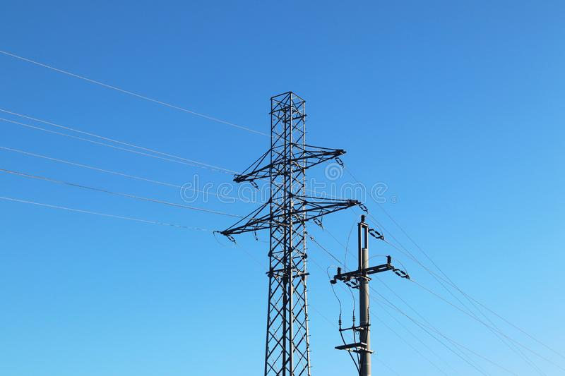 Electrical network of high voltage. Transportation of electricity through the high-voltage line. Metal tower with wires and cables royalty free stock image