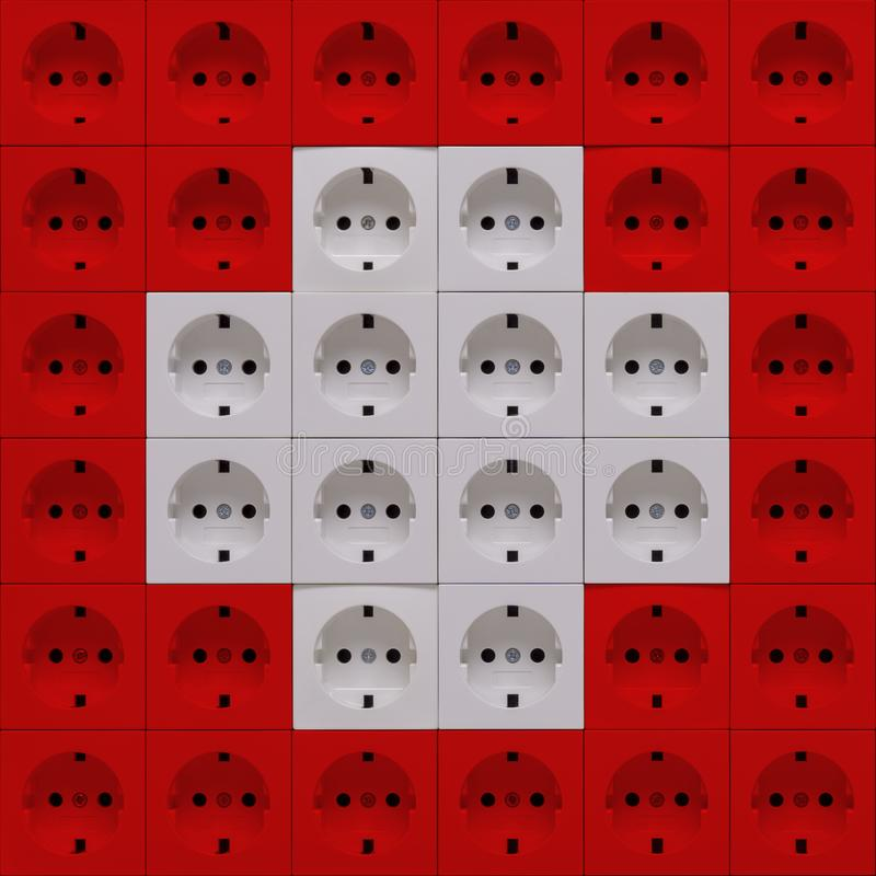 Electrical outlets in the colors of the flag of Switzerland stock image