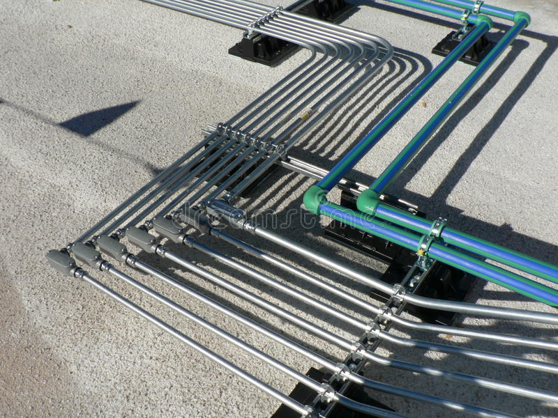 Electrical Pipe Rack on Roof. Emt conduit bending and installation all straight lines and supported stock photo