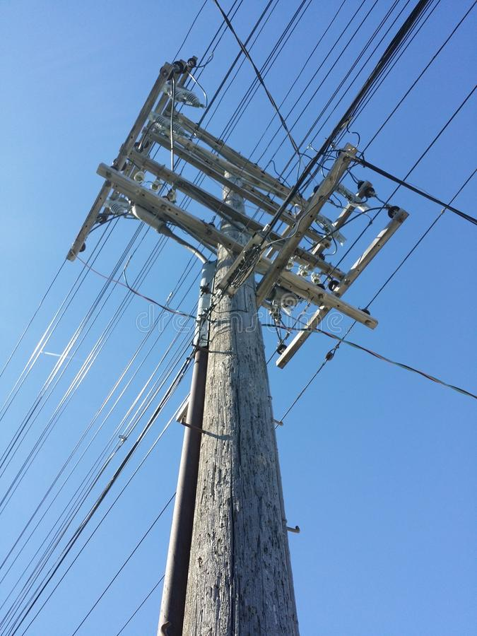 Electrical Pole with wires looking upward. Wooden Electrical Pole with wires looking upward stock photos