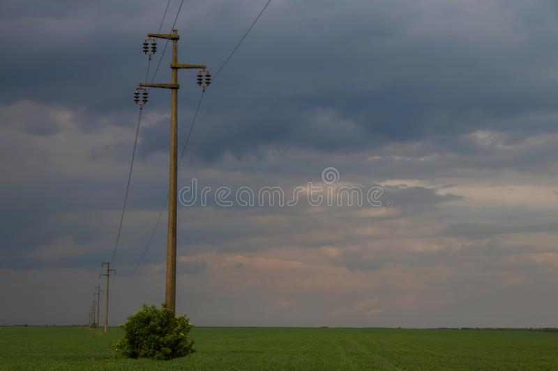 Electrical poles in a row. With beautiful country side landscape and dramatic skies stock photos
