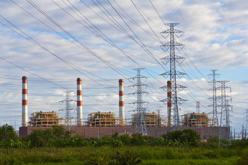 Electrical power plant and pylons stock photography