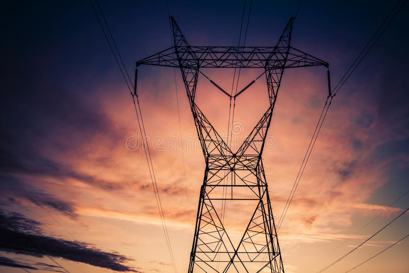 Electrical power transmission towers. Over the desert in Arizona at Sunset stock photography