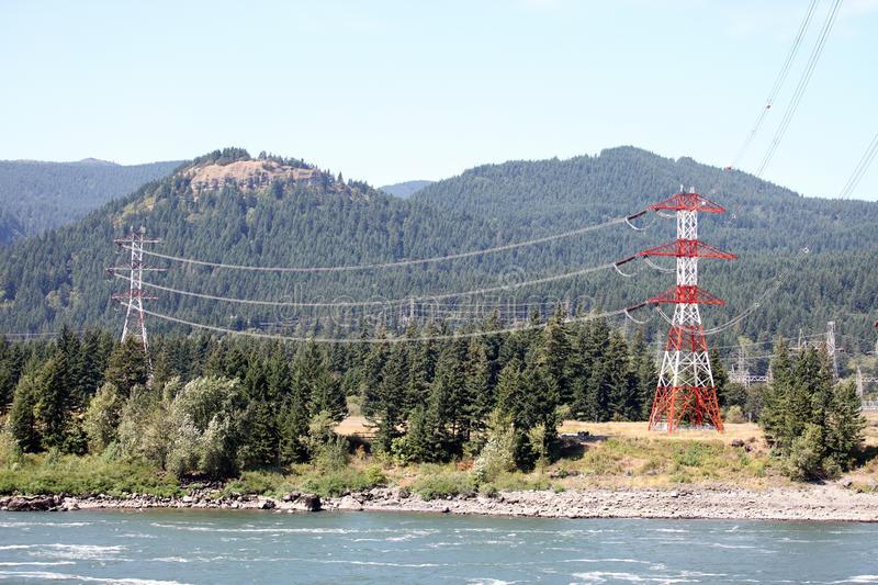 Electrical pylons with high tension electrical wires, royalty free stock photography